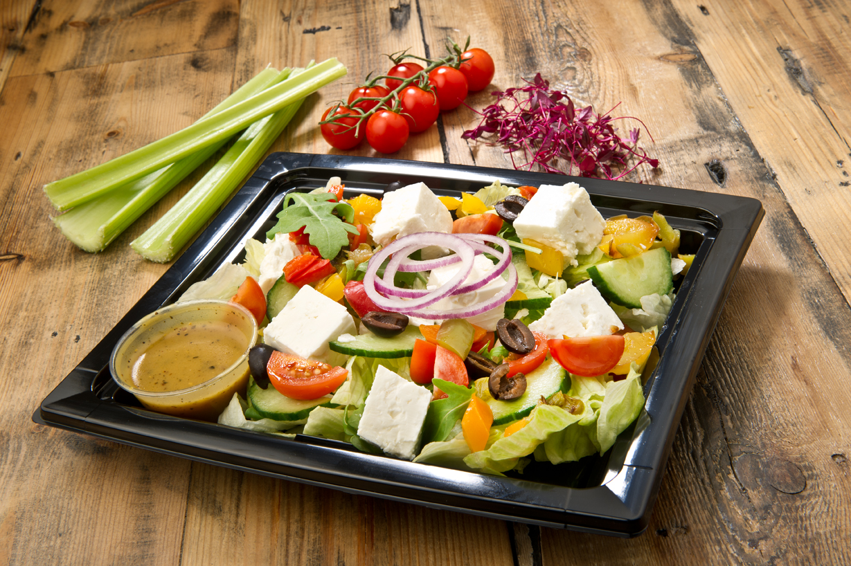 Fresh salad prepared for events or delivery