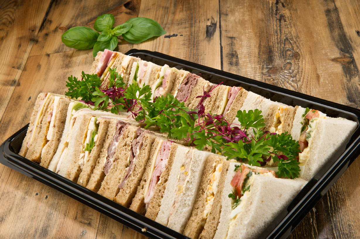 Platter of assorted sandwiches ready for delivery
