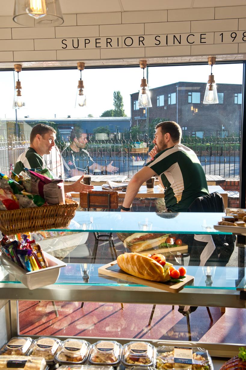Men having a discussion in the Superior Espresso Bar
