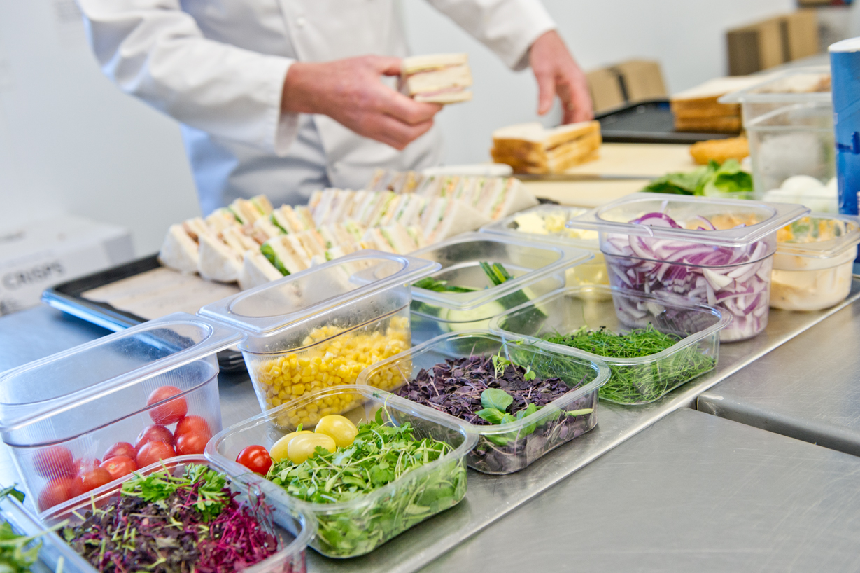 Sandwich platter being prepared with ingredients on display