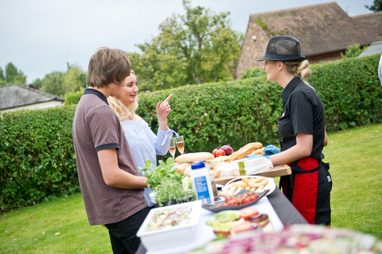 Clients discussing catering service options outdoors