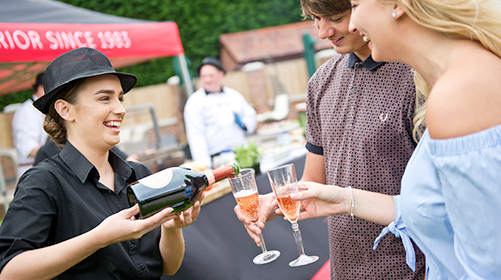 Catering staff serving drinks