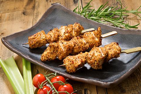 Crispy chicken skewers presented on dish